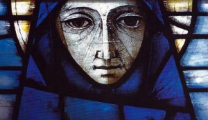 Detail: Added and stained blue flashed glass on either side of Madonna